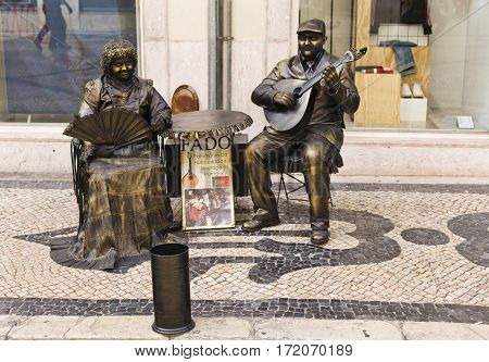 LISBON, PORTUGAL - September 26, 2016: Living statues impersonating Fado the Portuguese national song in downtown Lisbon Portugal