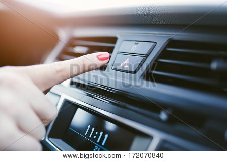 Woman Turns On The Emergency Lights In The Car.