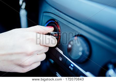 Woman Regulates Heating In Her Car.