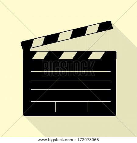 Film clap board cinema sign. Black icon with flat style shadow path on cream background.