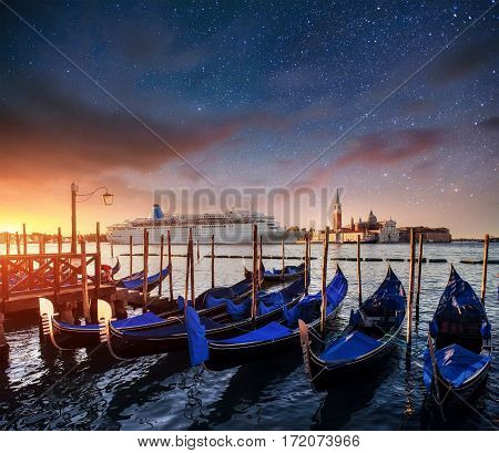 Fantastic views of the gondolas. Starry sky night. fantastic milky way. Moored on the Piazza San Marco from San Giorgio di Maggiore church in the background - Venice, Italy, Europe