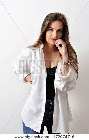 Model testshoot of sensual fashion model is posing in white shirt