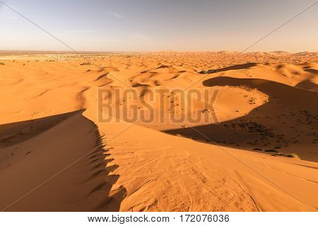 Awesome view from one of the highest dunes in the Sahara Erg Chebbi. On the left side you cann see Merzouga, Morocco.