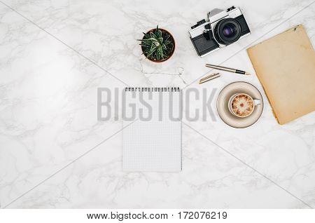 Accessories for travel top view on white marble table background with copy space. Adventure and wanderlust concept image with travel accessories. Preparing for an exotic trip, journey and sightseeing.