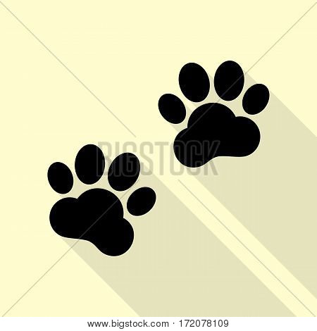 Animal Tracks sign. Black icon with flat style shadow path on cream background.