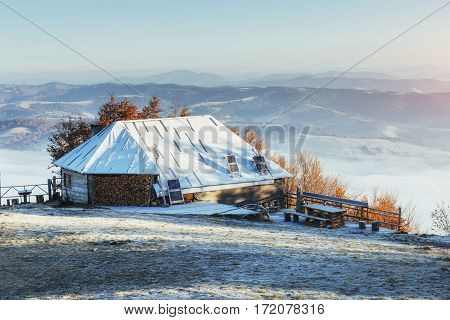 cabin in the mountains in winter. Beauty world