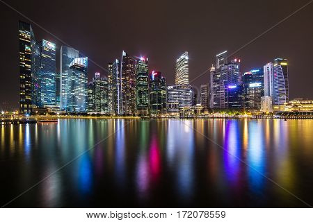 Singapore - June 24, 2016: Singapore skyline and illuminated financial district night view