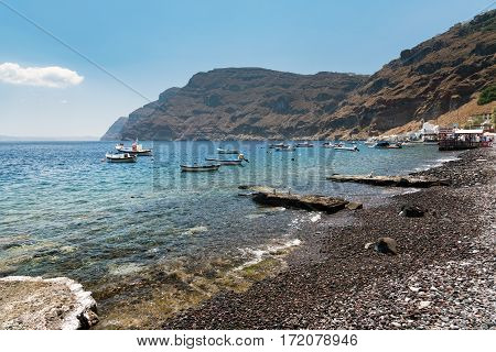 TIRASSIA, GREECE - AUGUST 2015: Small boats at lagoon of Tirassia island. Tirassia is a small island in caldera of Santorini island, Greece
