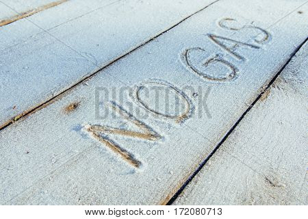Writing on the snow. Wooden texture. Symbols on wooden board.