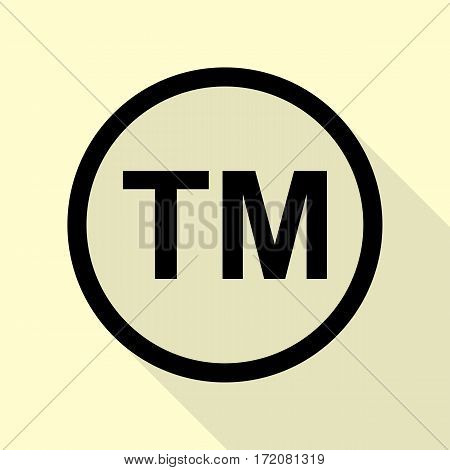 Trade mark sign. Black icon with flat style shadow path on cream background.
