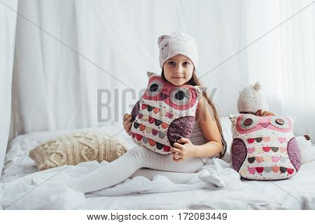 Child in soft warm pajama playing in bed