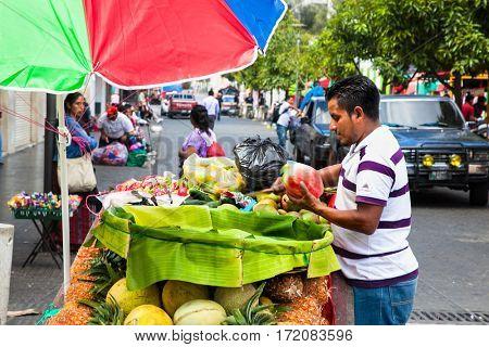 GUATEMALA CITY, GUATEMALA-DEC 25, 2015: Mayan sell a  Guatemalan fruits at the street of Guatemala city on Dec 25 2015. Guatemala.