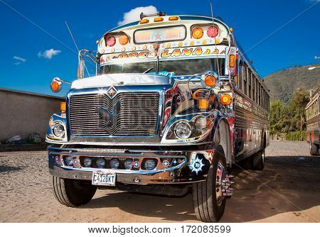 ANTIGUA,GUATEMALA -DEC 25,2015:Typical guatemalan chicken bus in Antigua, Guatemala on Dec 25, 2015.Chicken bus It's a name for colorful, modified and decorated bus in various latin American countries