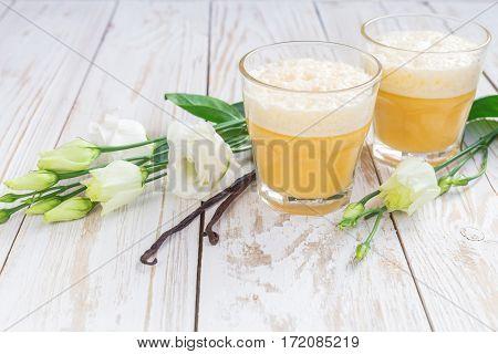 Traditional Homemade Eggnog And White Eustoma Flowers
