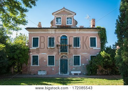 Venice Italy - September 21 2015: Typical house in Venetian style abandoned in the Venetian countryside.