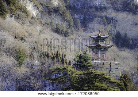 Shanxi Province, the Chinese Mianshan, snow, a lonely kiosk stands in the mountains.