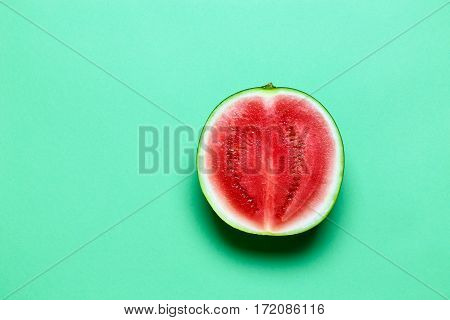 Half of Sweet Juicy Mini Watermelon on Green Copy Space. Top View.