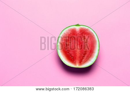 Half of Sweet Juicy Mini Watermelon on Pink Copy Space. Top View.