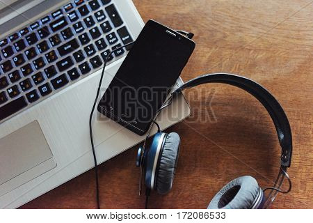 Laptop and headset and phone on the table