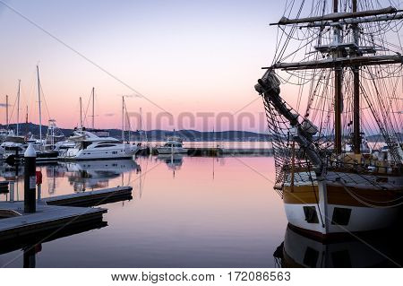Sail boat at sunset in the port of Hobart, Tasmania