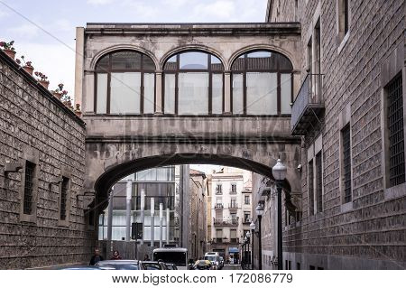 Barcelona, Spain on April 20, 2014: Ancient street and buildings in historic center in La Ribera quarter of Barcelona.
