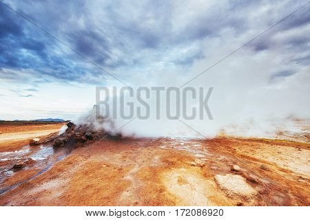 Fumarole field in Namafjall Iceland. The picturesque landscapes forests and mountains
