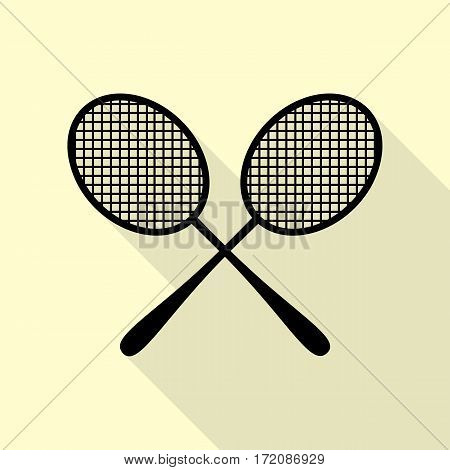 Tennis racquets sign. Black icon with flat style shadow path on cream background.