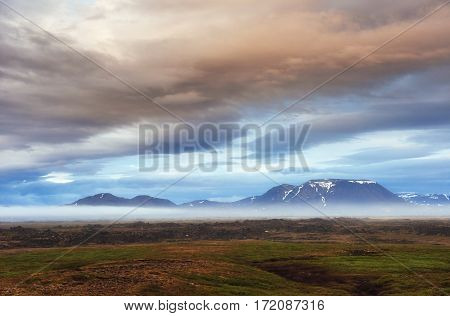 The picturesque landscapes of forests and mountains of Iceland