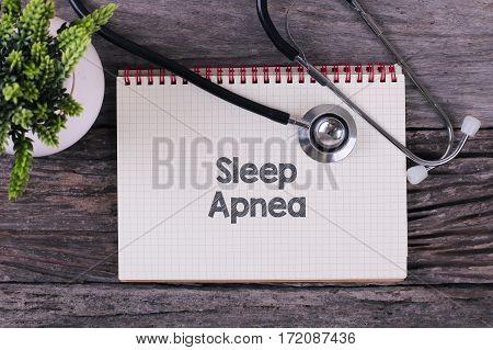 Sleep Apnea Word On Notebook,stethoscope And Green Plan.