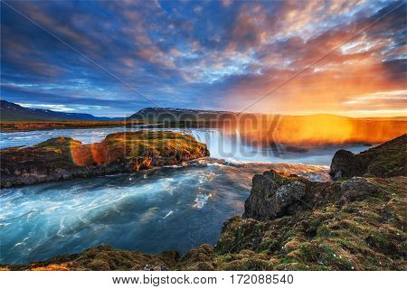 Godafoss waterfall at sunset. Fantastic landscape. Beautiful cumulus clouds. Iceland, Europe