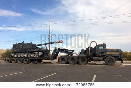 PHOENIX AZ - FEBRUARY 17 2017: Maricopa County Sheriff Tank on a tractor trailer platform with a famous War on Drugs slogan Phoenix Arizona