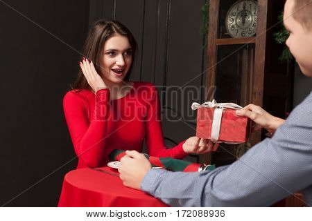 Attractive gift to a beautiful woman in restaurant