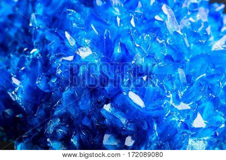 Blue icy salt crystal closeup