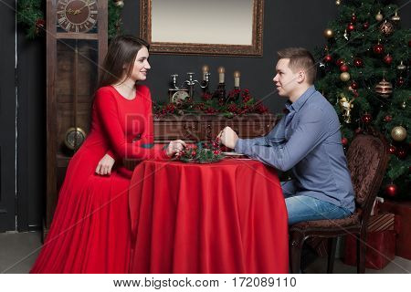 Young smiling couple at luxury restaurant