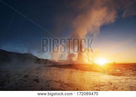 Fantastic sunset Strokkur geyser eruption in Iceland. Fantastic colors