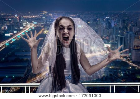 Screaming zombie bride, night city on background