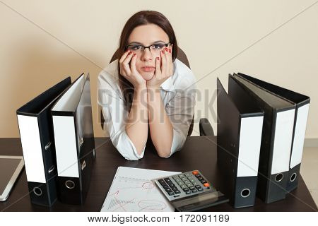 Bookkeeper sitting between documents folders
