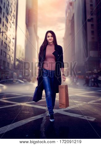 Woman with shopping bags crossing a city street