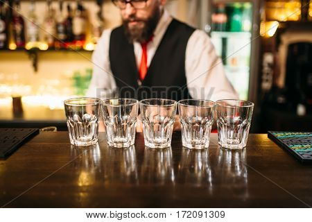 Empty glasses on wooden bar counter
