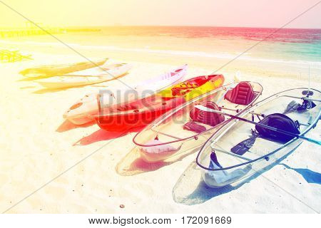 kayaks on the tropical beach with color filters