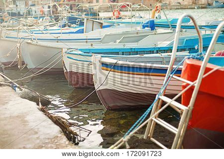 old green fishing boats in the bay