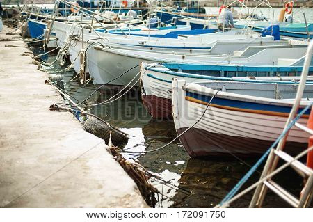 Group of small fishing boats working row-boats with fishing paraphernalia etc