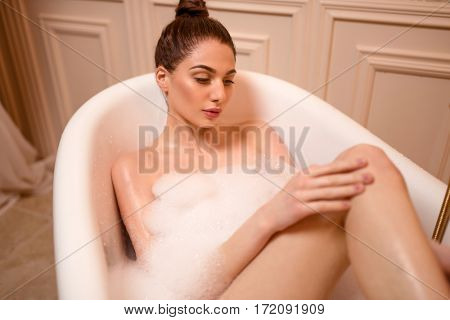 Woman skincare in the bathtub