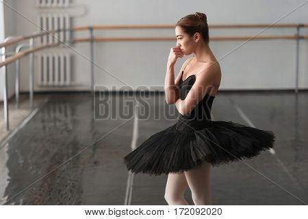 Female ballet dancer resting after rehearsal