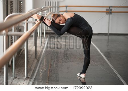 Skill ballet dancer posing in class