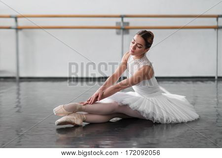Beautiful ballerina posing in ballet class