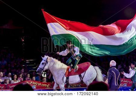 SZEGED, HUNGARY - JUNE 12. 2016 - horse riding performance of Hungarian National Circus by the Richter Group with a Hungarian flag