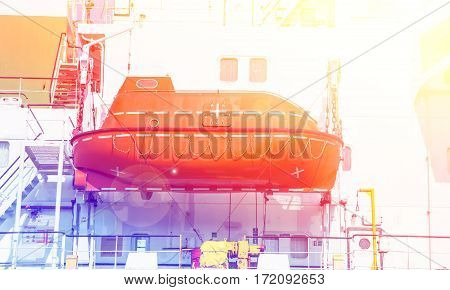 lifeboat on a cargo ship with color filters
