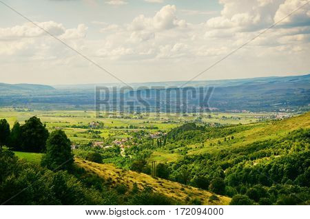 Natural Landscape With Fields and Forests Over Cloudy Sky