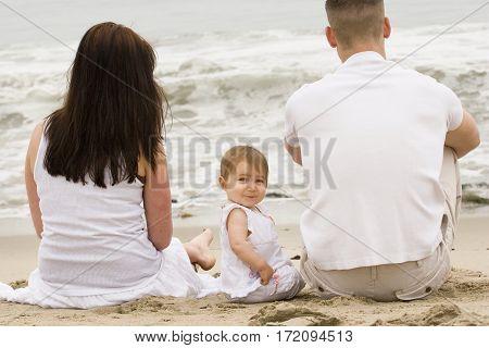Happy family having fun outdoors at the beach.